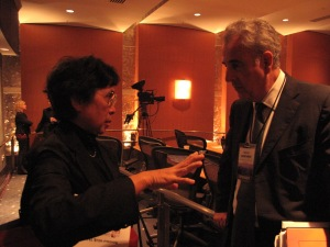 Michel Kazatchkine, executive director of the Global Fund to Fight AIDS, Tuberculosis, and Malaria, right, speaks with Thelma Tupasi, founder of the Tropical Diseases Foundation in the Philippines.