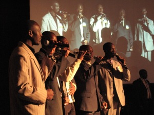 Members of Vocal Motion 6, a local music group, sing Namibia's national anthem at the HIV/AIDS Implementers' Meeting opening session Wednesday in Windhoek.