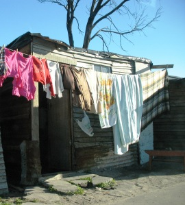 Many people live in cramped quarters, as in this photo from Gugulethu, near Cape Town