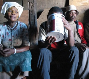 The woman on the left runs a local saloon, in Gugulethu, where people drink beer made from corn.  TB can spread in such enclosed spaces.