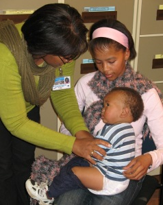 Child receiving his pneumococcal vaccine.